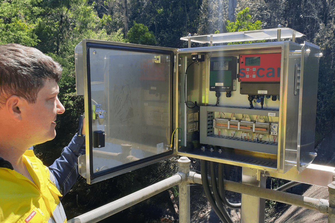 Workman looking at control panel